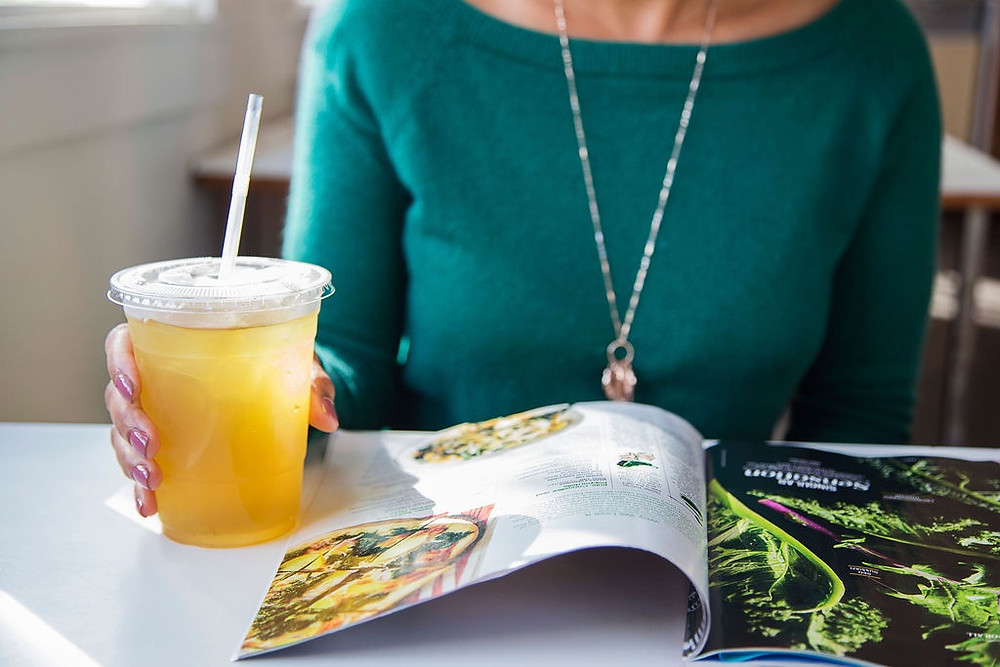 Stock photo of a woman with a cup of green tea.