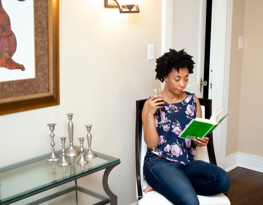 Woman reading You're a Badass at Making Money