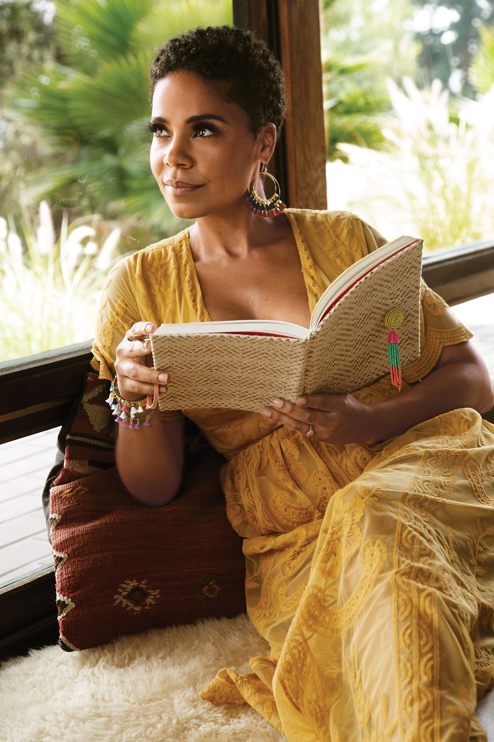 Sanaa Lathan reflecting on a book she's reading.