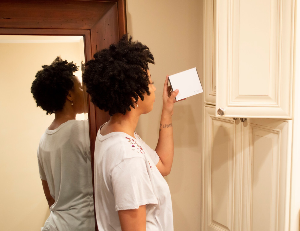 Woman putting period products in a cabinet.