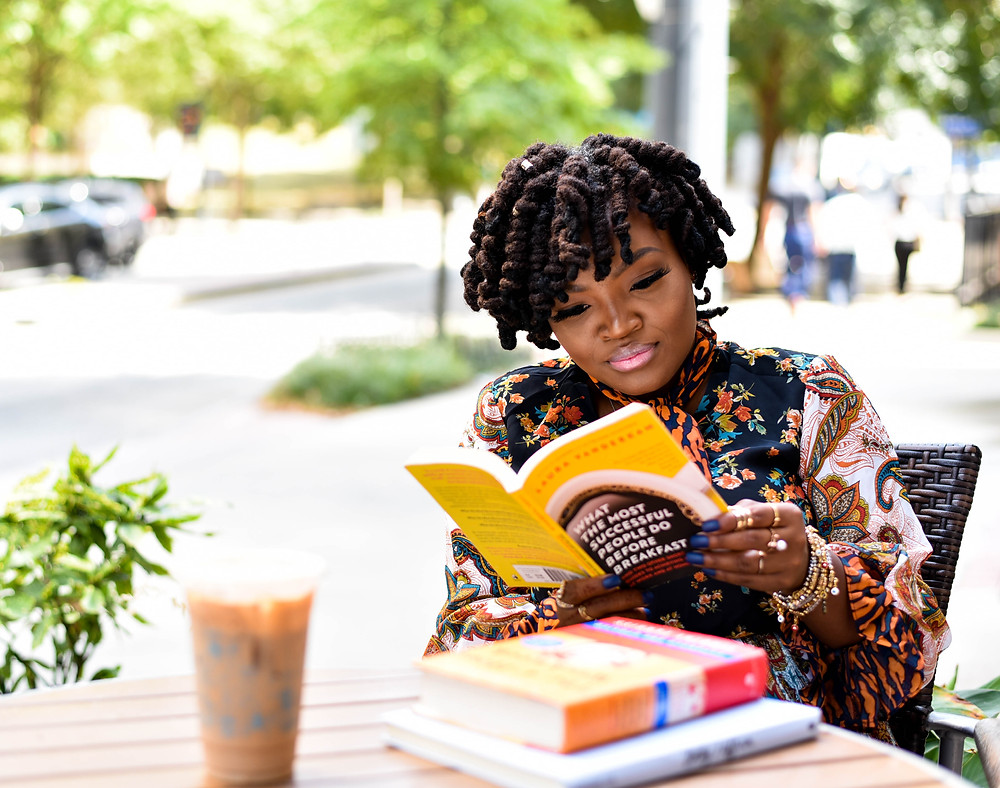 Black woman reading a book.