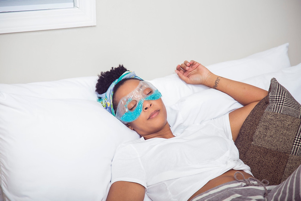 Woman resting with an eye mask