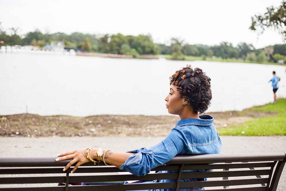 Woman sitting at City Park, in New Orleans.