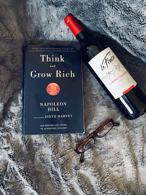 Book and a bottle of wine.