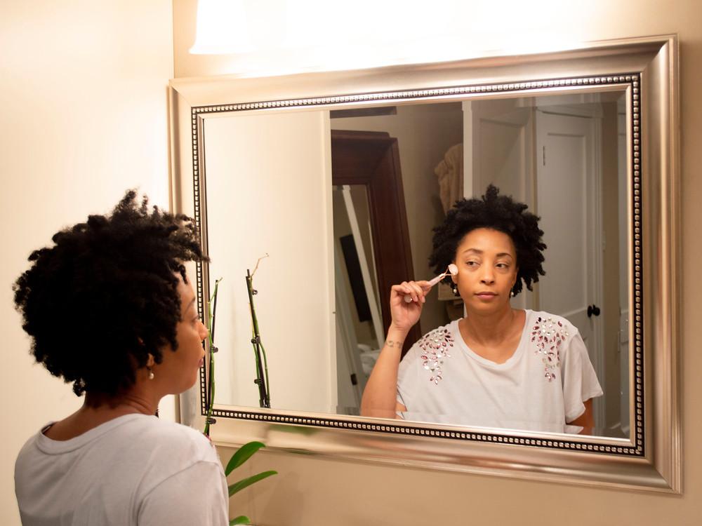 Woman using a facial massager.