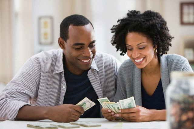Black couple talking about money