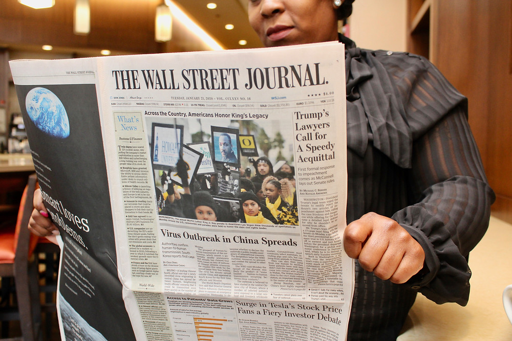 Woman reading The Wall Street Journal