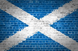An image of the Scotland Saltire flag painted on a brick wall in an urban location.jpg