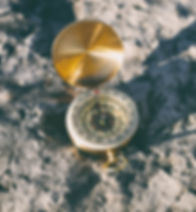 gold-colored%20compass%20on%20stone_edit