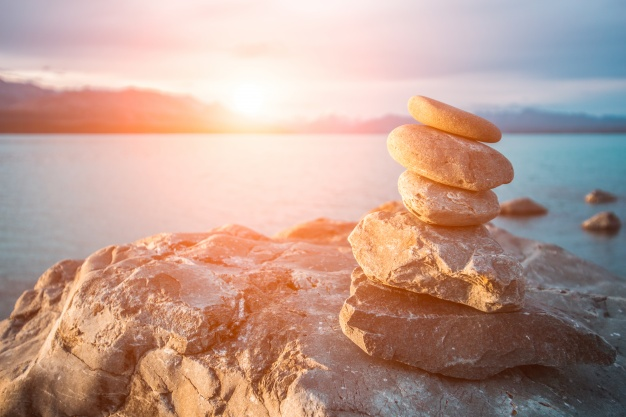 stones-stacked-in-the-sea-at-sunset_1088