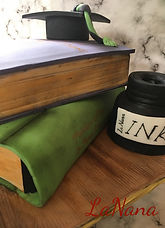 Graduation cake, featuring books and ink bottle. Vegan and gulten-free