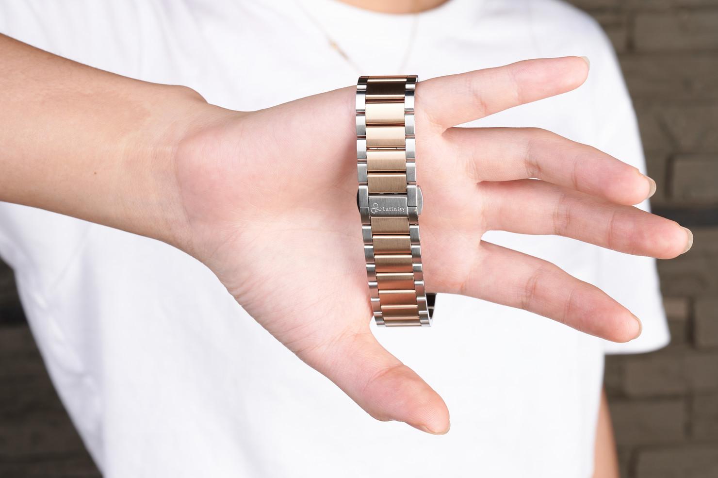 Gold with hand X Harmony Titanium bracel