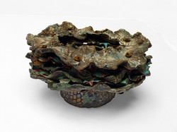 Leaf Bowl created in clay, stained and woven with copper leaves