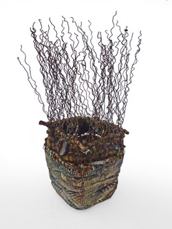 Woven Ceramic Vessel with wire,found objects and fiber