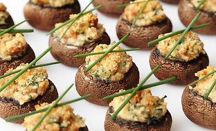Baked mushroom caps stuffed with sausage
