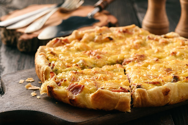 Homemade quiche with leek, ham and chees
