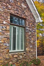 window-shutters-stone-facade-17121651.jpg