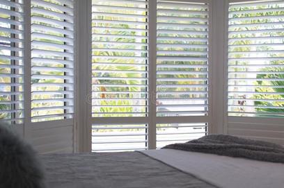 plantation-shutters-selective-focus-luxury-white-bedroom-226917761.jpg