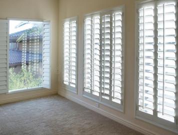 white-plantation-style-wood-shutters-26958837.jpg