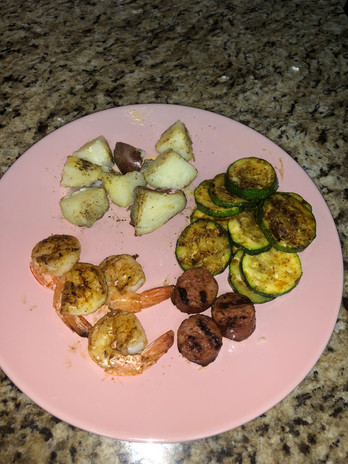 Grilled shrimp, zucchini, red potatoes, and turkey sausage