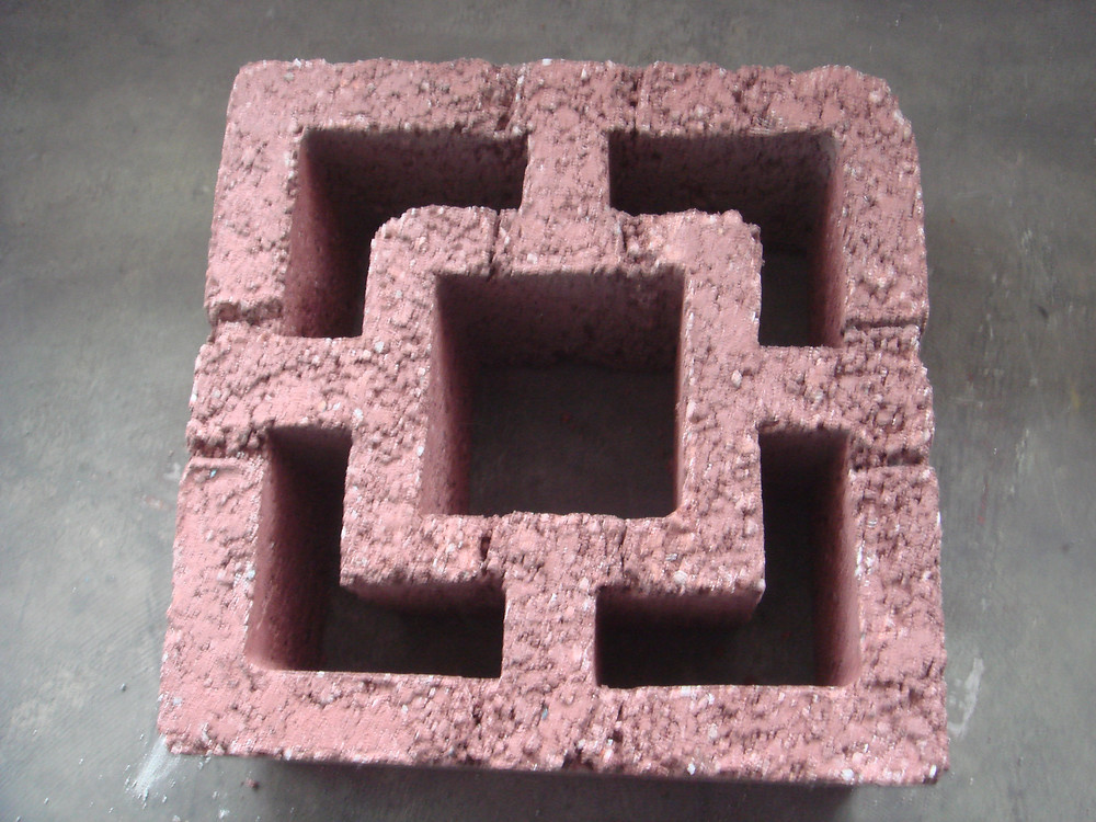 Concrete breeze block with red oxide