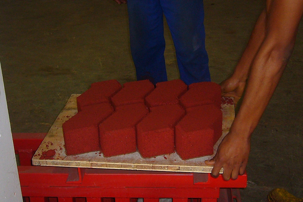 Red colouring achieved by adding oxide to the brick mixture before compacting