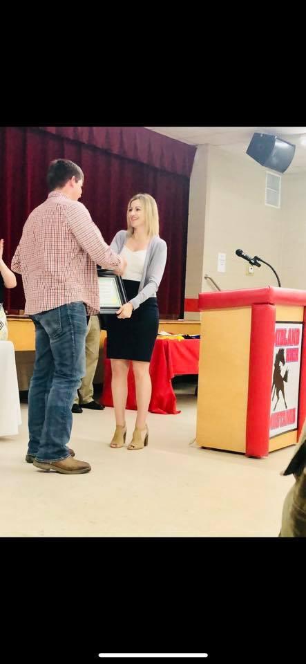 Briar receiving Award