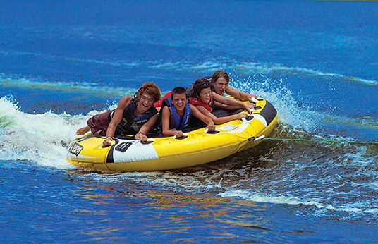 4 teens on an O'Brien towable tube