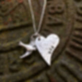 Loved one's ashes and bird charm