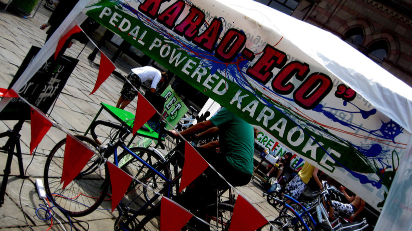 Pedal Powered Karaoke sign painting on recycled banner