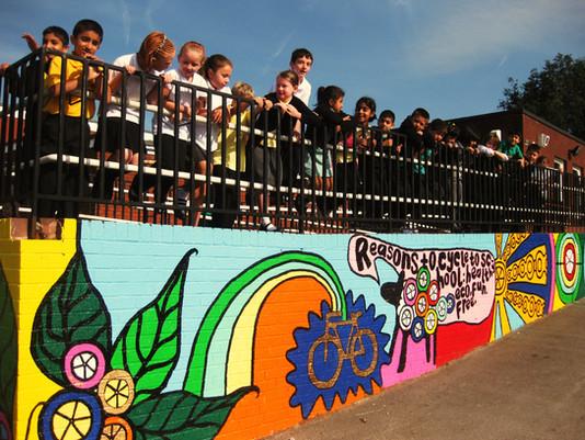 Proud children presenting their work