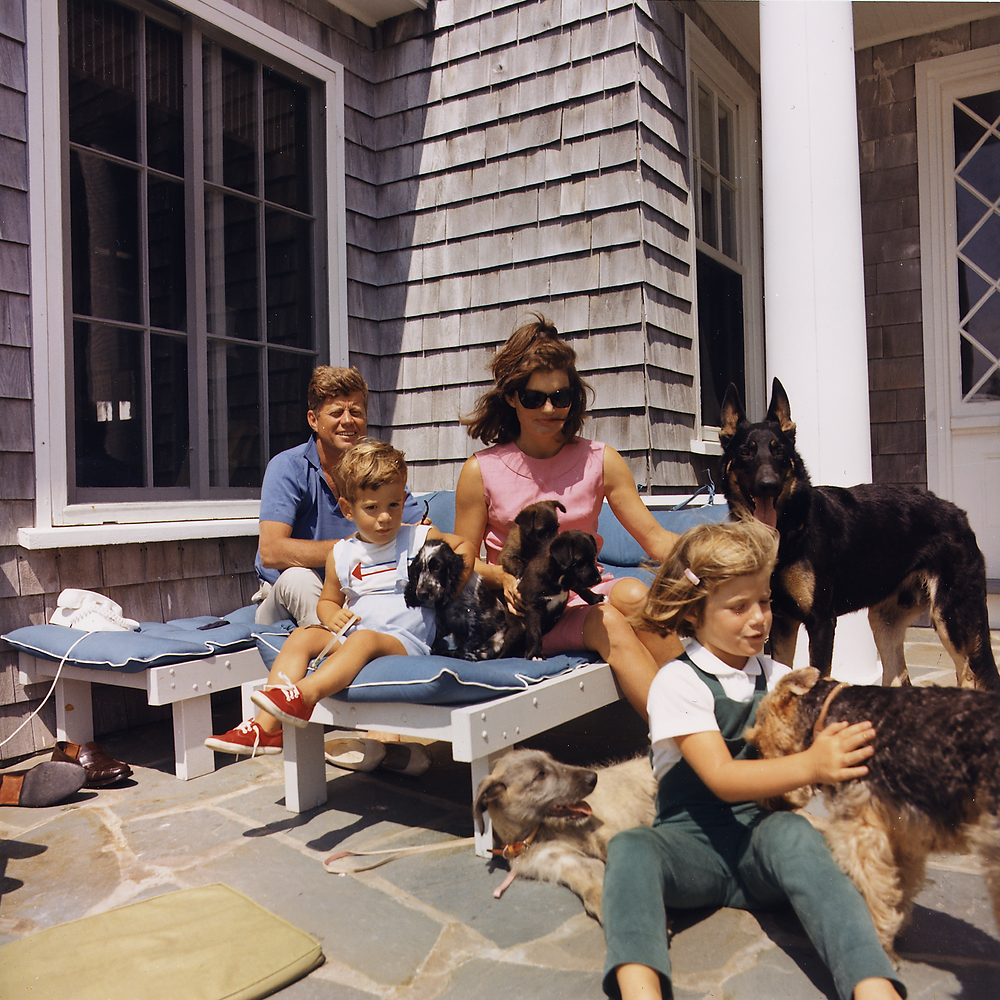 The Kennedy Family sitting outside with their children and pet dogs