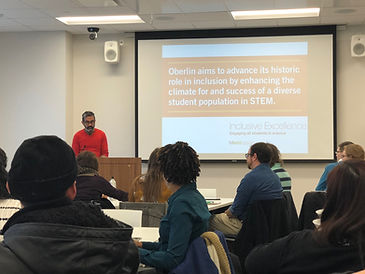 A man gives a presentation to a group of faculty and staff about Inclusive Excellence at Oberlin College.