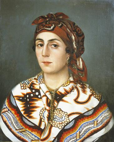 Portrait de femme portant le mouchoir de tête et le châle d'indienne