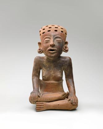 Statuette féminine assise