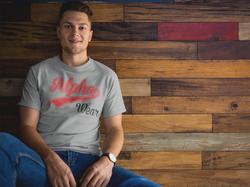 man-wearing-a-tshirt-mockup-while-sittin