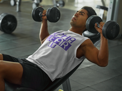 athletic-man-lifting-weights-at-the-gym-