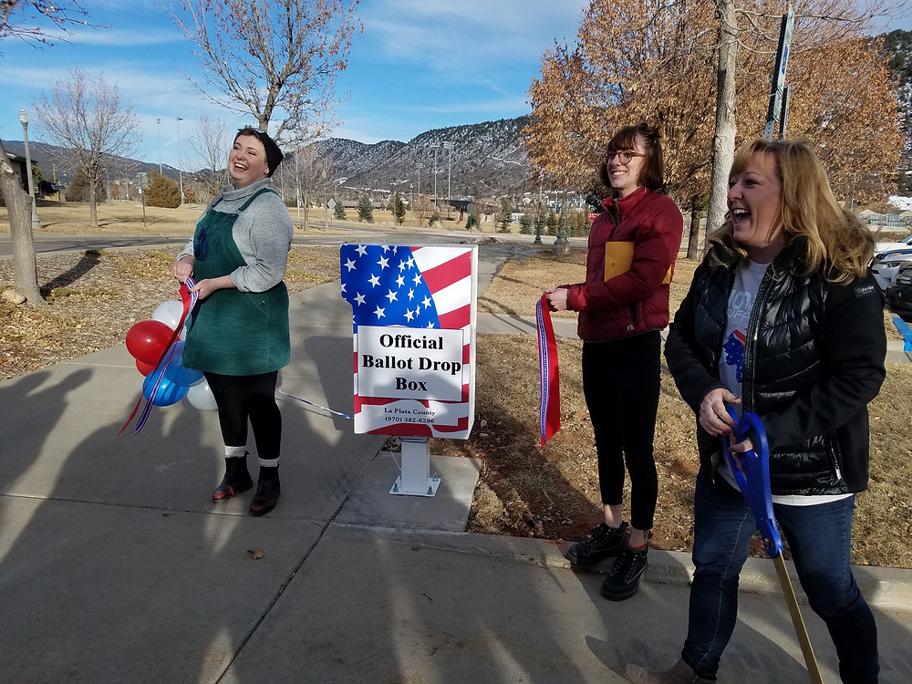 Tiffany Parker, LPC's County Clerk (right) unveils a new ballot drop box on FLC's campus with Allie and Olivia assisting, 2/14/20.