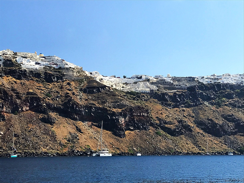Oia from the Catamaran Tour with Sunset Oia