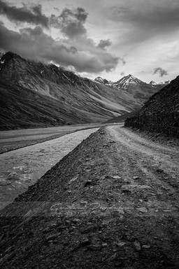 Artistic black and white landscape photograph of a stream running in the high Himlayan mountains of Spiti, India