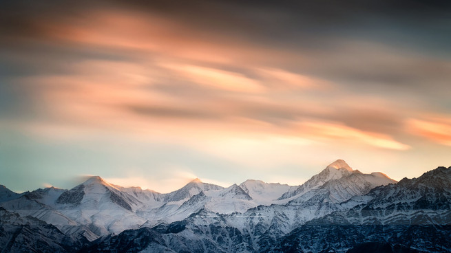 Artistic landscape photograph of beautiful clouds and colours over the high Himlayan mountains of Ladakh, India in winter
