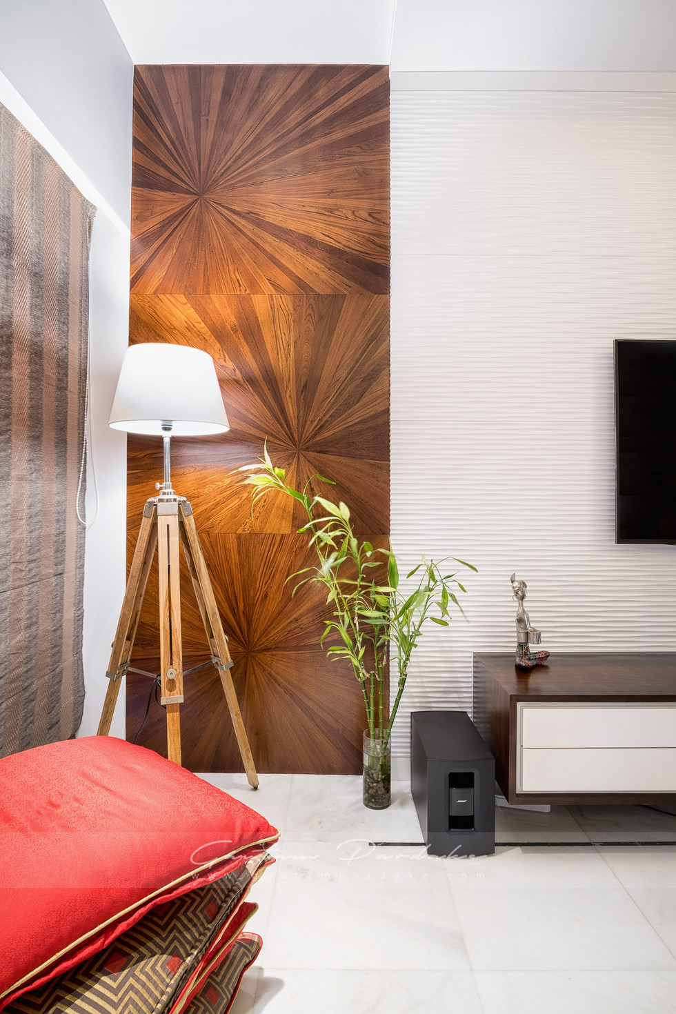 Interior photo of a bedroom corner with a woodboard in Colaba