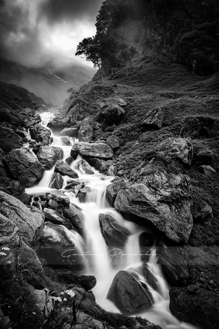 Artistic black and white landscape image of a stream in the high Himlayan mountains of India