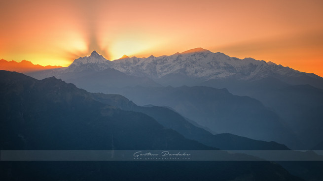 Beautiful landscape image with sunrise behind the mountain peak of NandaDevi in Himalayas in North India