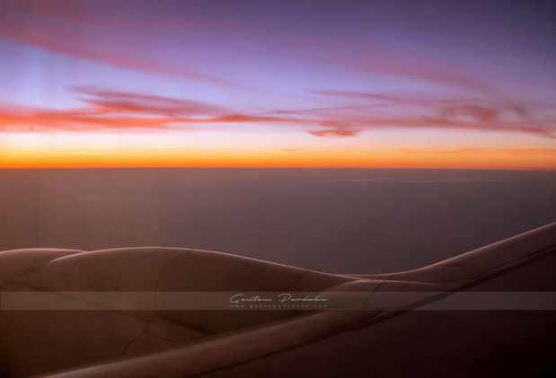 Beautiful landscape photograph with majestic sky at sunrise from an airplane over India