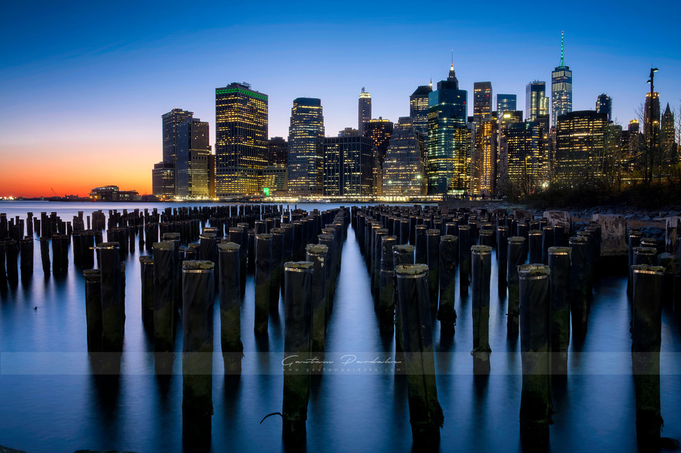 Beautiful image of Newyork city skyline as seen at night from Brooklyn