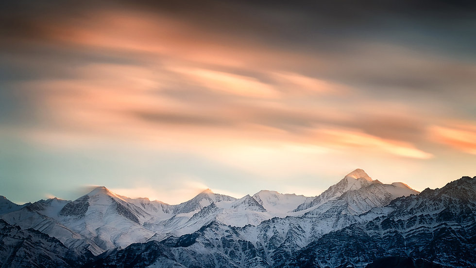 Landscape photo of Winter Ladakh featuring a sunset with clouds over Himalayan peak of Stok Kangri