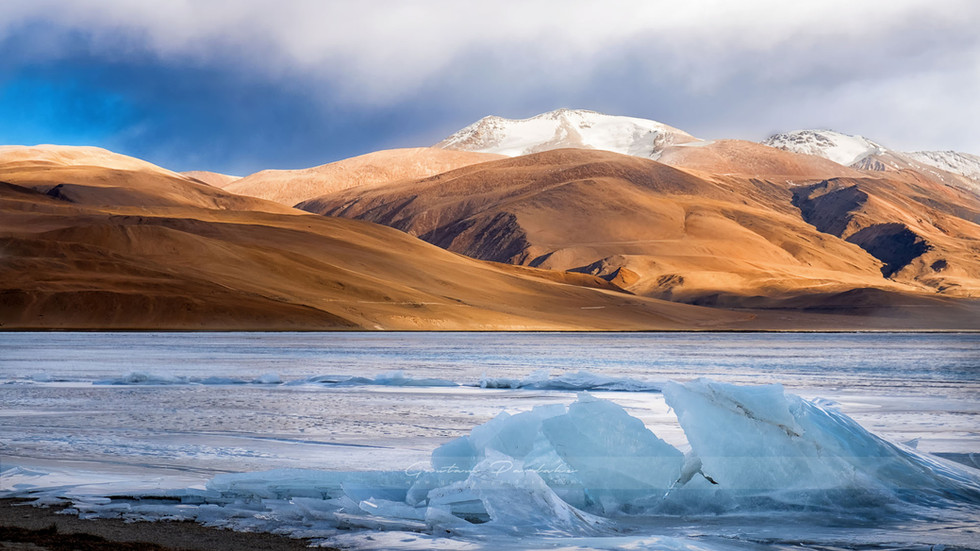 Beautiful landscape photograph of a frozen high altitude lake in the high Himlayan mountains of Ladakh, India