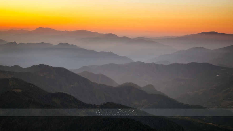 Beautiful landscape image showing layers of Himalayan mountains at sunrise in North India