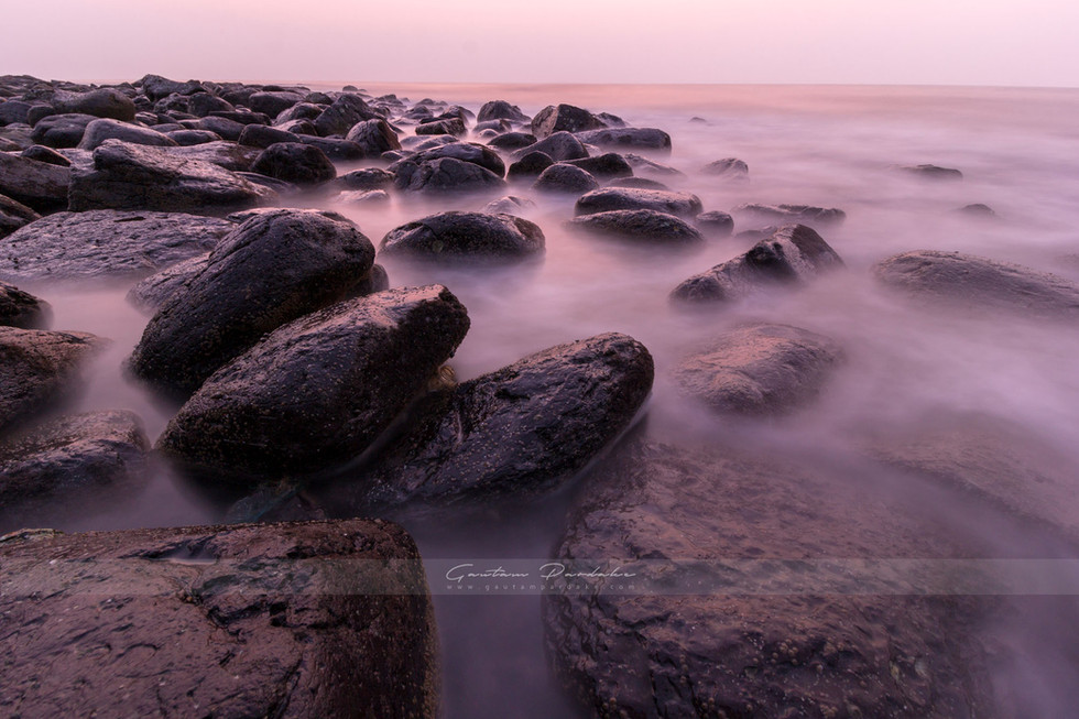 Beautiful landscape image with muted sunset colours at a rocky beach in India